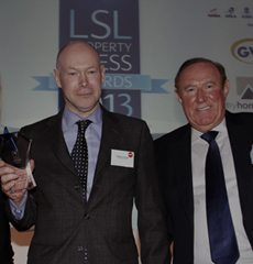 Sebastian O'Kelly receives his award, sponsored by Your Move, from Andrew Neil