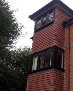 Missing tiles can be seen on the front of Crowthorne Lodge