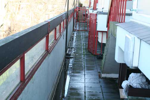 Water floods the gutters and gathers on the balconies of the top floor. There have been complaints of damp by residents below